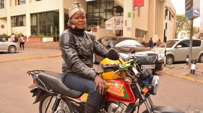 Faith Khakai, One Of The Few Female Motorcycle Taxi Operators In Kenya